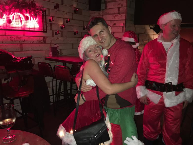 Manchester socialising Santa pub crawl
